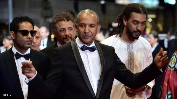 "Mauritanian director Abderrahmane Sissako (C) arrives with Tunisian actor Hichem Yacoubi (L), Tunisian-born actor Abel Jafri (back) and Malian musician and actor Pino Desperado (Ibrahim Ahmed) for the screening of the film ""Timbuktu"" at the 67th edition of the Cannes Film Festival in Cannes, southern France, on May 15, 2014. AFP PHOTO / BERTRAND LANGLOIS (Photo credit should read BERTRAND LANGLOIS/AFP/Getty Images)"