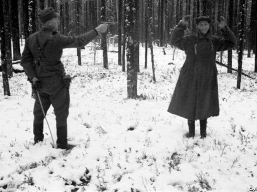Russian spy laughing through his execution in Finland during The Winter War, 1939