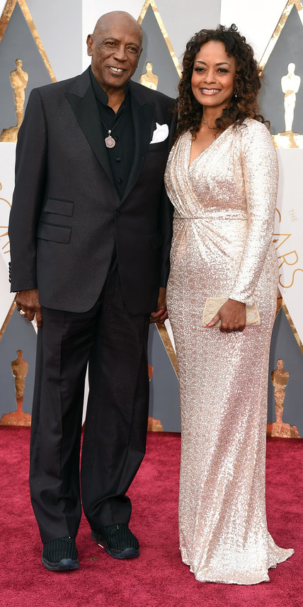 Louis Gossett Jr., left, and Candy Brown arrive at the Oscars on Sunday, Feb. 28, 2016, at the Dolby Theatre in Los Angeles. (Photo by Jordan Strauss/Invision/AP)